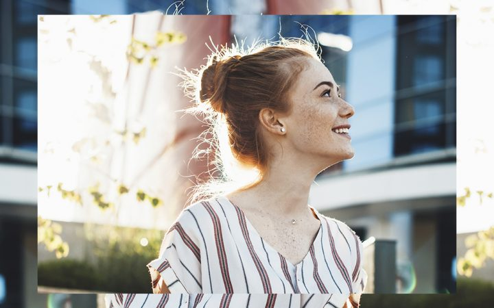 White woman smiling in the sun
