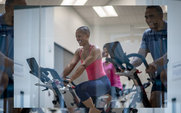 man and woman on exercise bikes