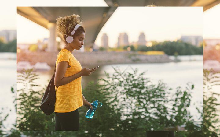 woman with headphones on phone