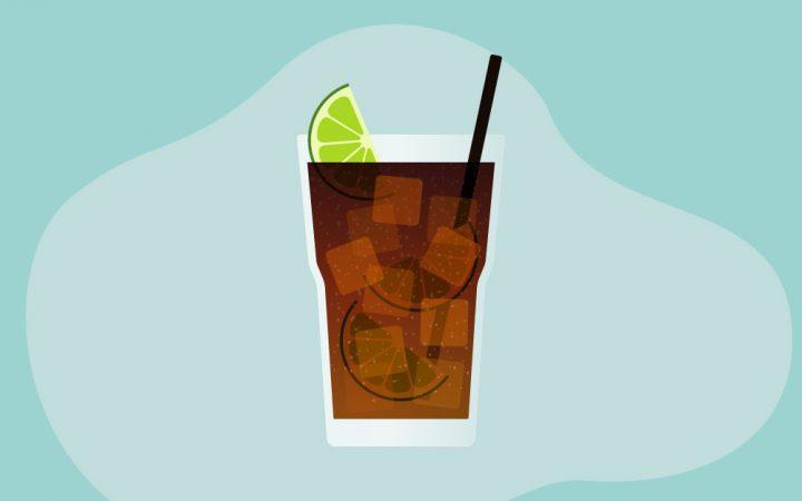 Glass with dark beverage inside