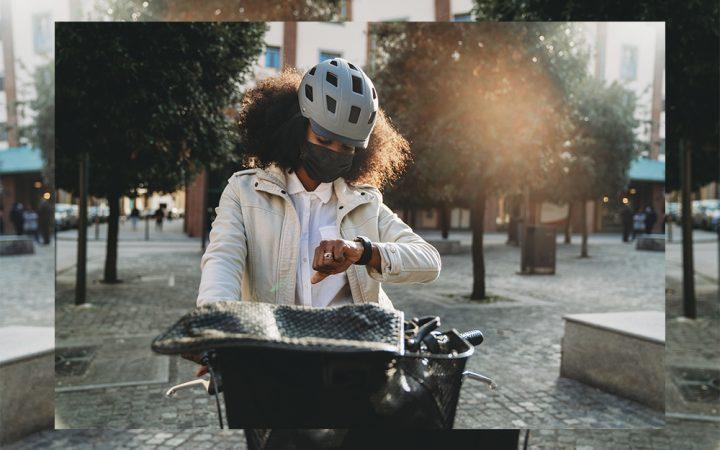 Woman on bike in sunshine