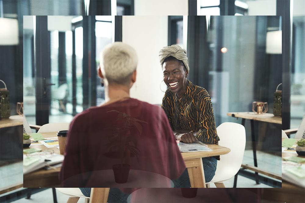 Women laughing at work